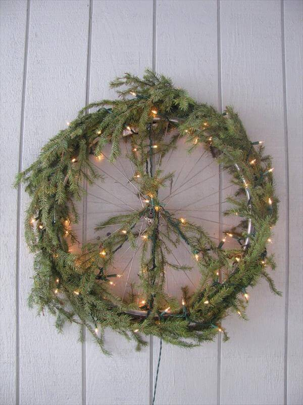 diy recycled vintage bike wheel wreath idea
