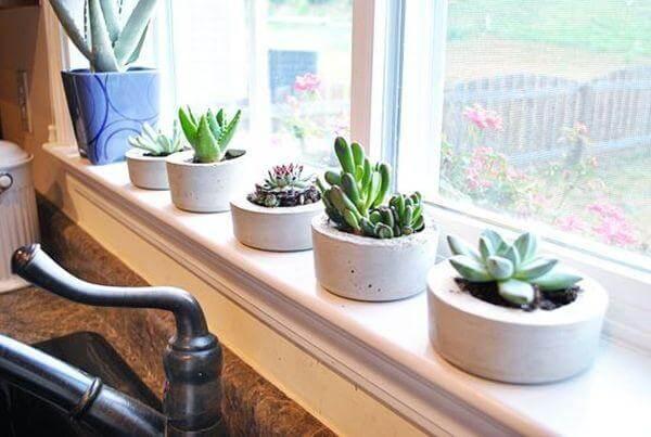 selfmade round concrete planters