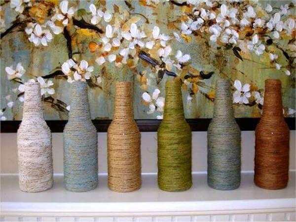 diy yarn wrapped empty bottles vases