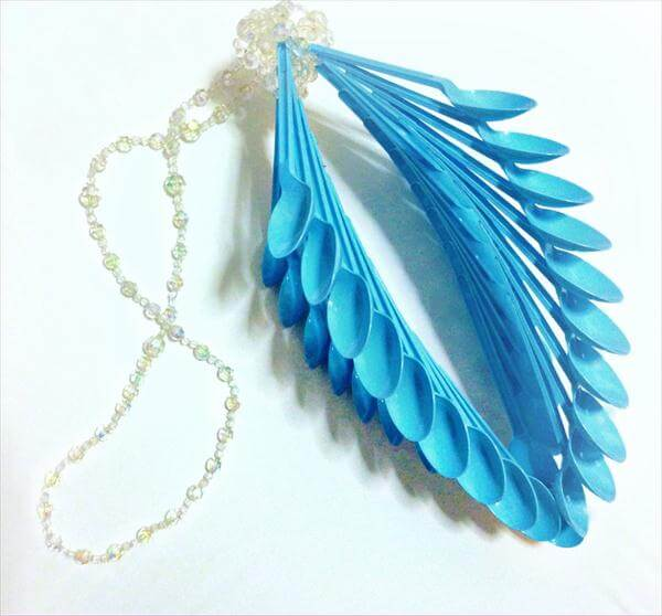 upcycled blue plastic spoon celing art