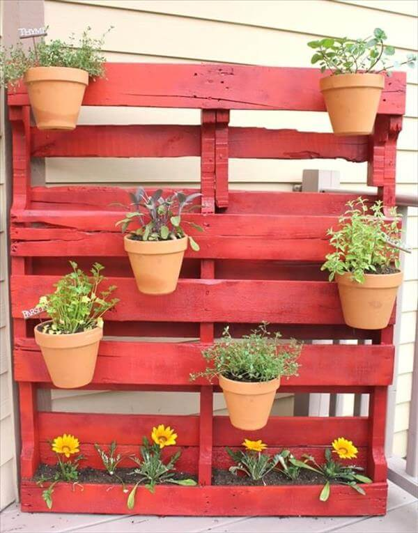 red stained pallet vertical planter